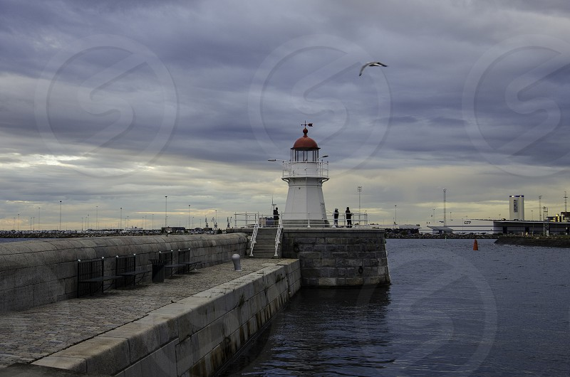 Fishing at a lighthouse photo