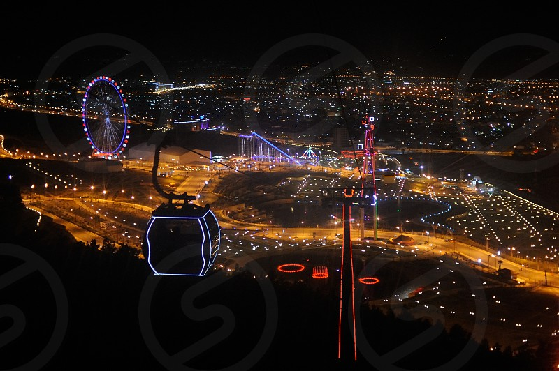 A view at night of Chavy Land an amusement park in Sulaymaniyah in the Kurdish Region of Iraq. photo
