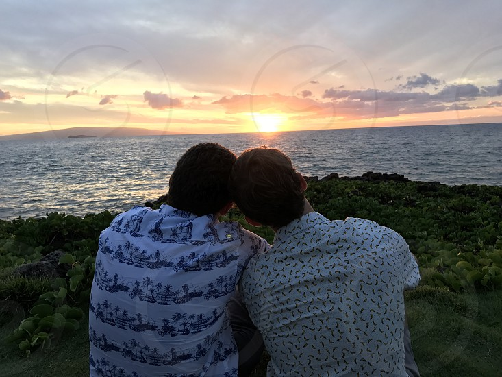 Gay couple love sunset Hawaii  photo