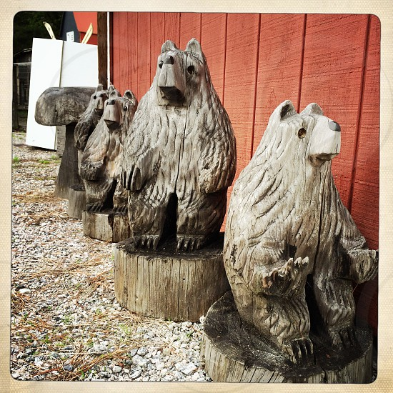 Three carved wood bears standing watch.  photo