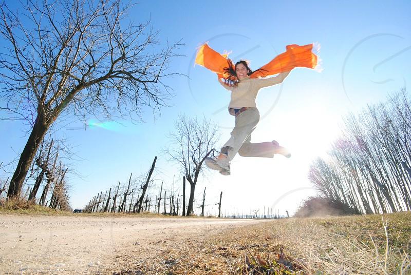 women's orange scarf photo