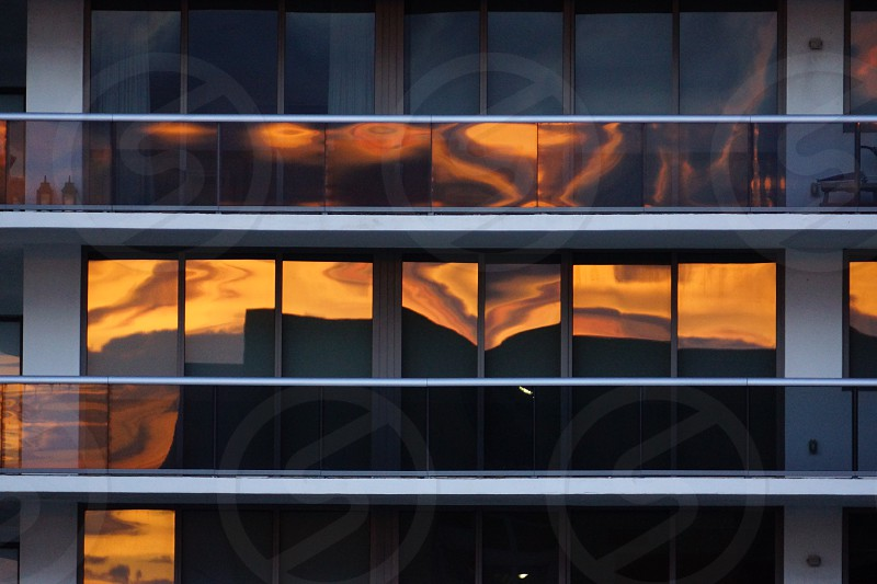 Sunset reflected off building photo