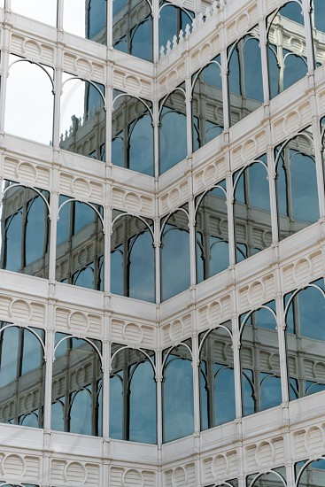 Glass building with mirror windows and blue sky photo