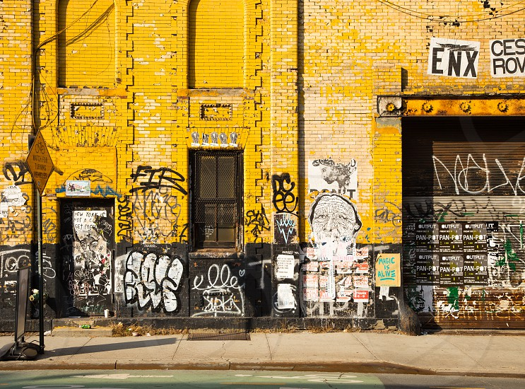 yellow label logo warehouse graffiti brick williamsburg industrial photo
