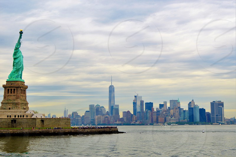 New York Statue of Liberty city cityscape water buildings  photo