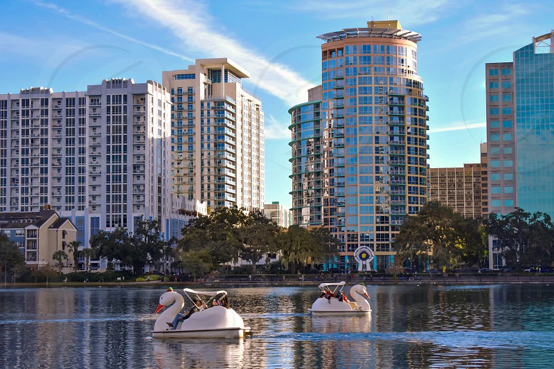 Orlando Florida . December 24 2018. Colorful buildings and swan boats in Lake Eola Park at  Orlando Downtown area. photo