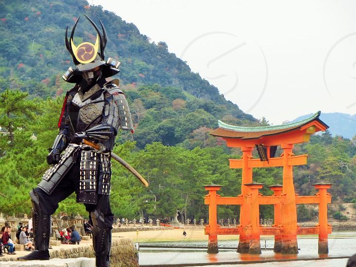 man in black asian costume photo