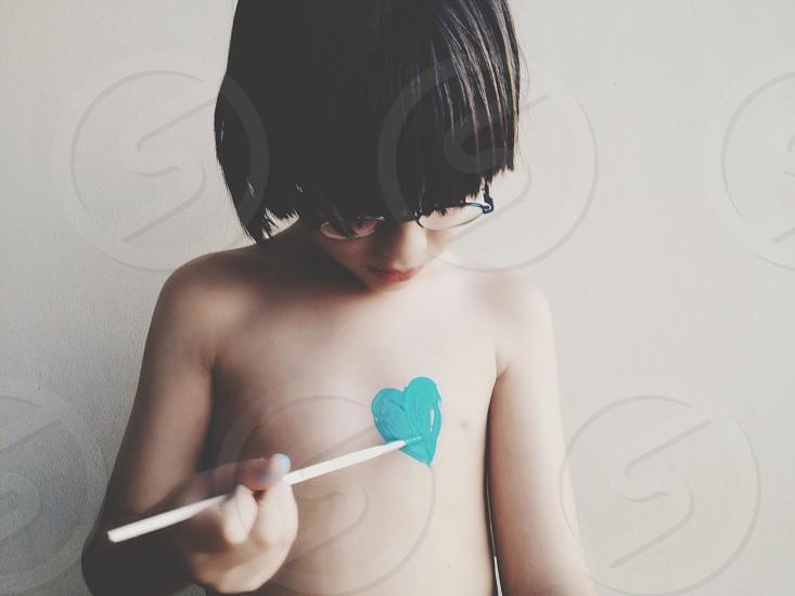 boy holding chop stick photo