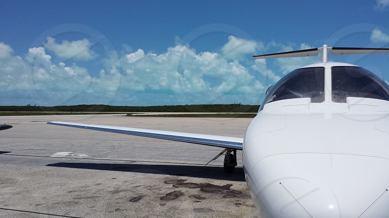 Private jet Caribbean clouds aircraft airplane photo