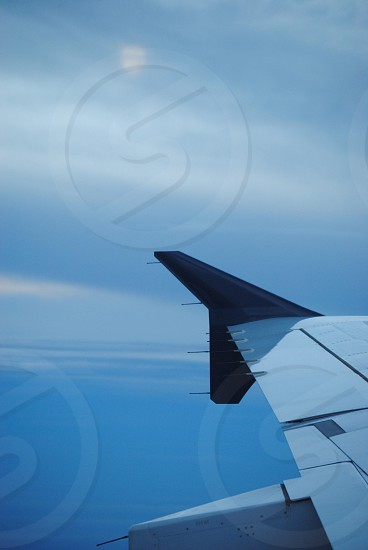white and gray airplane wing photo
