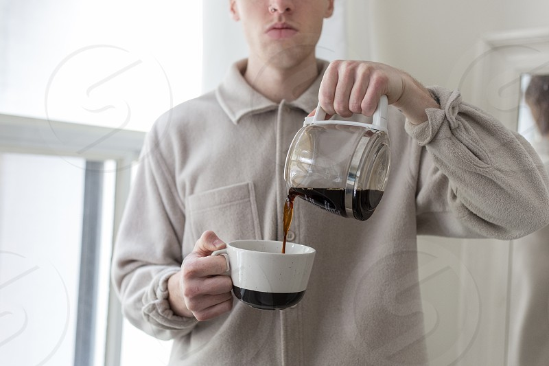 Food editorial - pouring and drinking coffee. photo