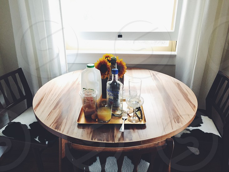 clear drinking glass bottles on table photo