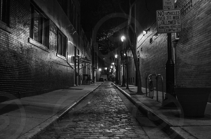 grayscale photography of street surrounded by walls photo