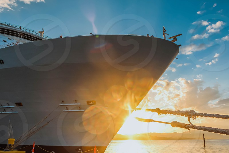 Close view of the front of the cruise ship with sunrays photo