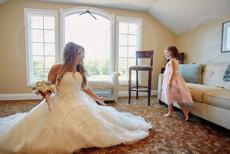 Bride flower girl bride and flower girl barefoot admiring adoring bridal suite sweet girl princess for a day prancing around the bride happy photo