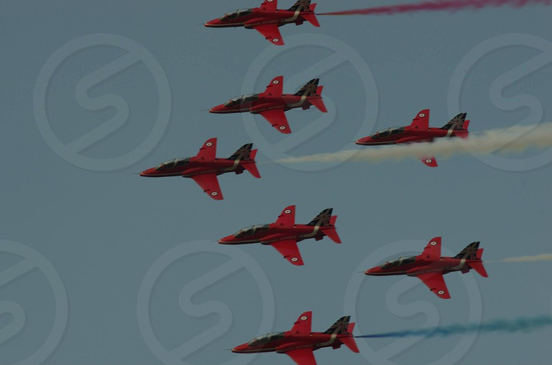 red black fighter planes in unison photo