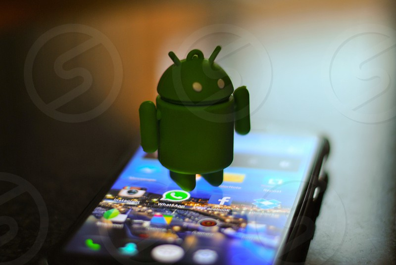 android figure on android smartphone photo