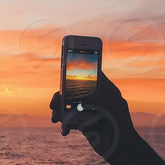 white iphone taking sunset photo photo