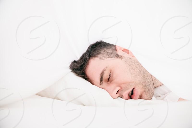 Young man sleeping photo