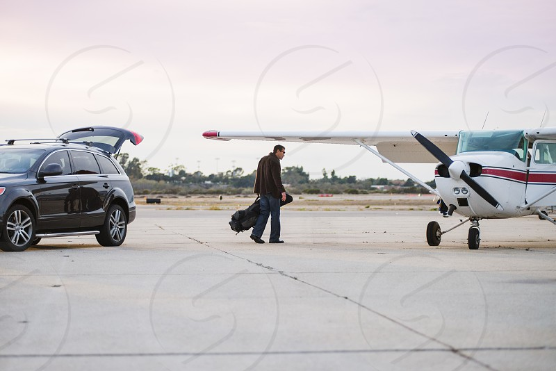businessman fly airplane private travel photo