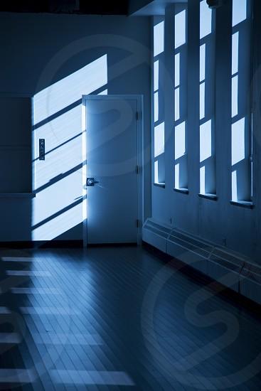 Light thru windows form geometric patterns on wall. photo
