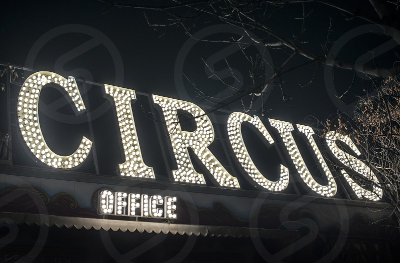 Text circus in the night. Circus office illuminated. Many lamps photo