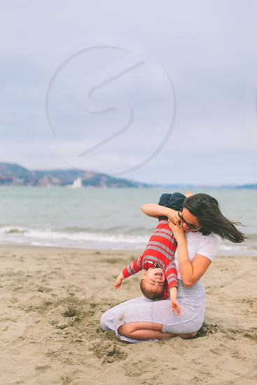 A mother and son playing together on the beach in San Fransisco. photo