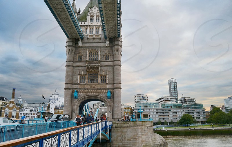 Tower bridge on a cloudy day in London photo