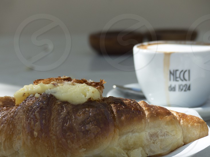 At Bar Necci Pigneto Rome Italy. Cappuccino and a cornetto. photo