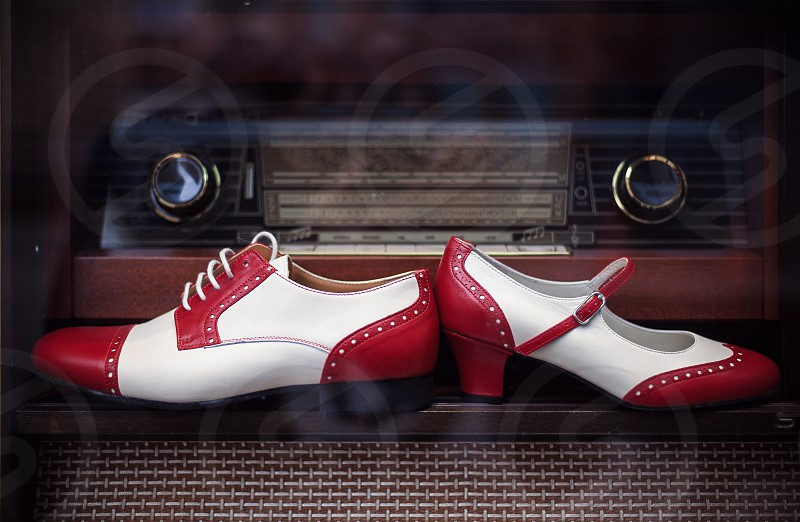 Closeup of female and male shoes vintage style in red and white.  photo
