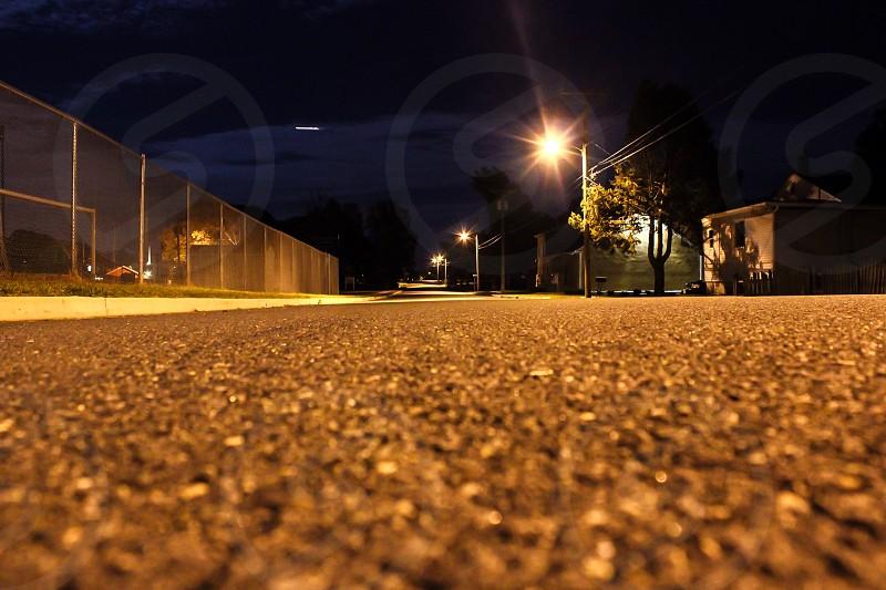 gray metal railings at night photo