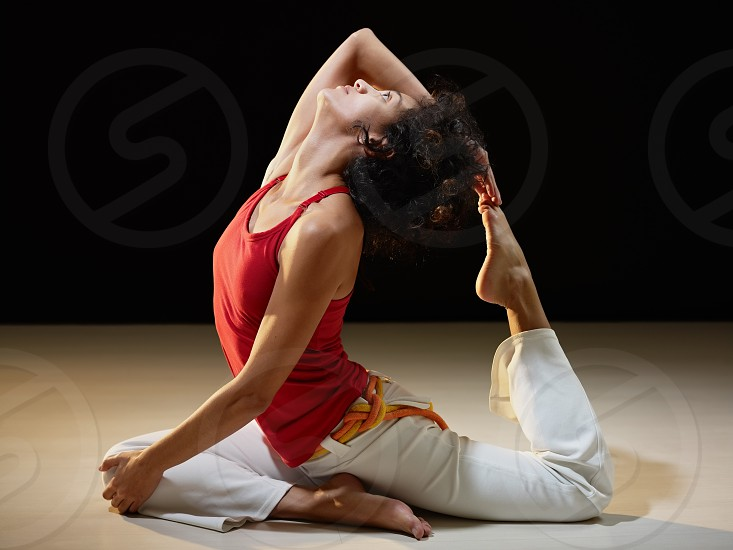 woman; exercising; contortionist; stretching; zen; yoga; meditation; 20s; adult; american; background; beautiful; bending; black; body; calm; concentration; copy space; curly; exercise; female; flexibility; flexible; foot; girl; gym; hand; healthy; hispanic; holding; indoor; latin; lifestyle; meditating; one person; peace; people; position; relax; serene; skill; spirituality; sport; sportswear; training; vitality; wellness; young; zen-like photo