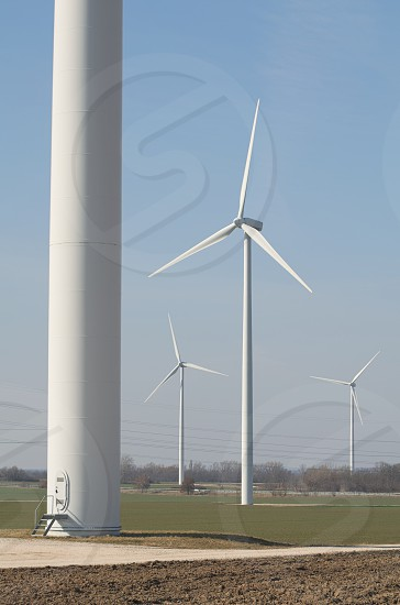 Wind Farm on Agricultural Land Daytime Vertical photo