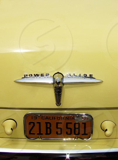Detail of license plate on a classic yellow sedan photo