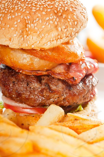 classic american hamburger sandwich with onion rings and french fries MORE DELICIOUS FOOD ON PORTFOLIO photo