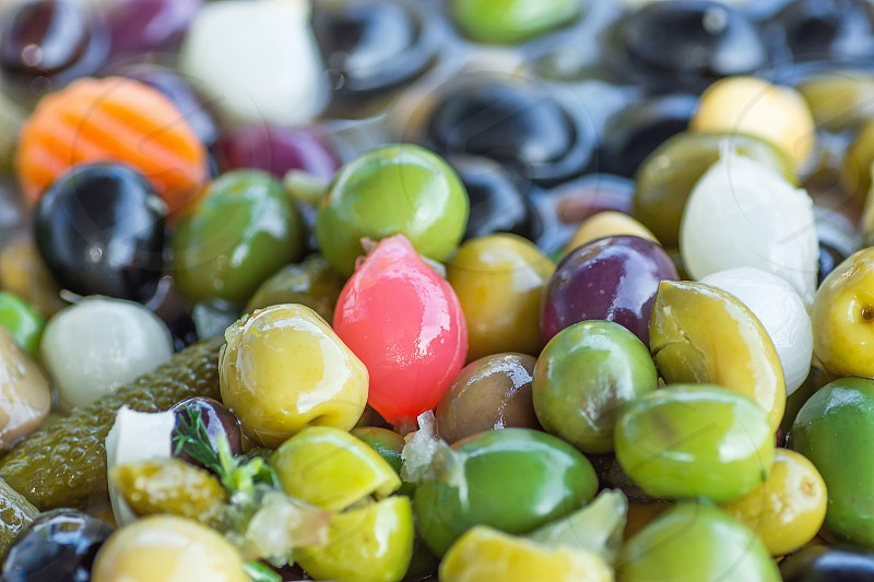 Assortment Variety of Handmade Artisanal Tapas Brine Cured Olives with Herbs Pearl Onions Vegetables at Mediterranean Farmers Market. Italian Spanish Greek Cuisine. Travel Lifestyle photo