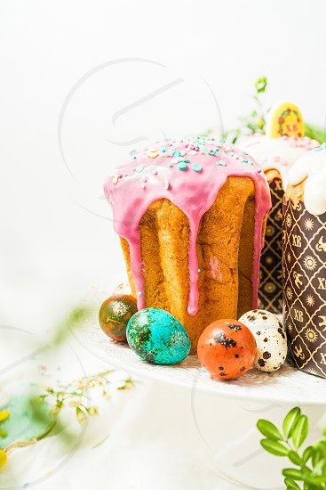 Easter cakes and colored eggs on a white background photo