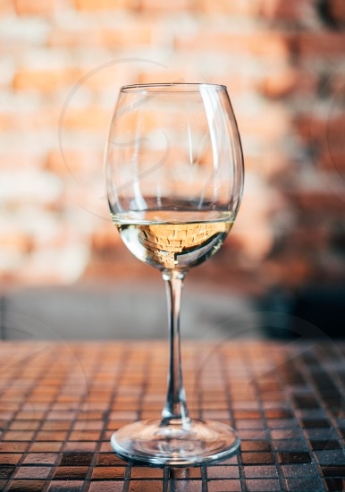 Glass of white wine on the table photo