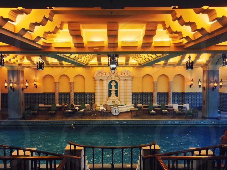 blue and beige lobby near lake photo