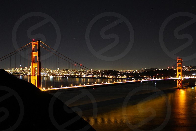 San Francisco Golden Gate Bridge Night lights Skyline Reflection photo