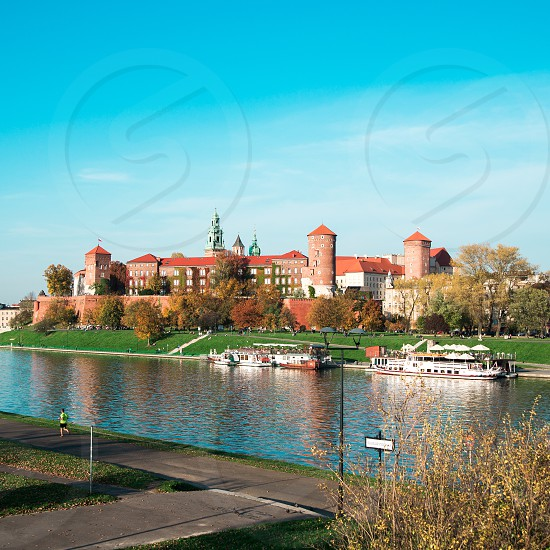 view of Wawel castle located on bank of Vistula river in Krakow city photo