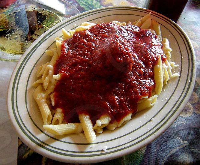 Mostaccioli with meatball and marinara sauce photo