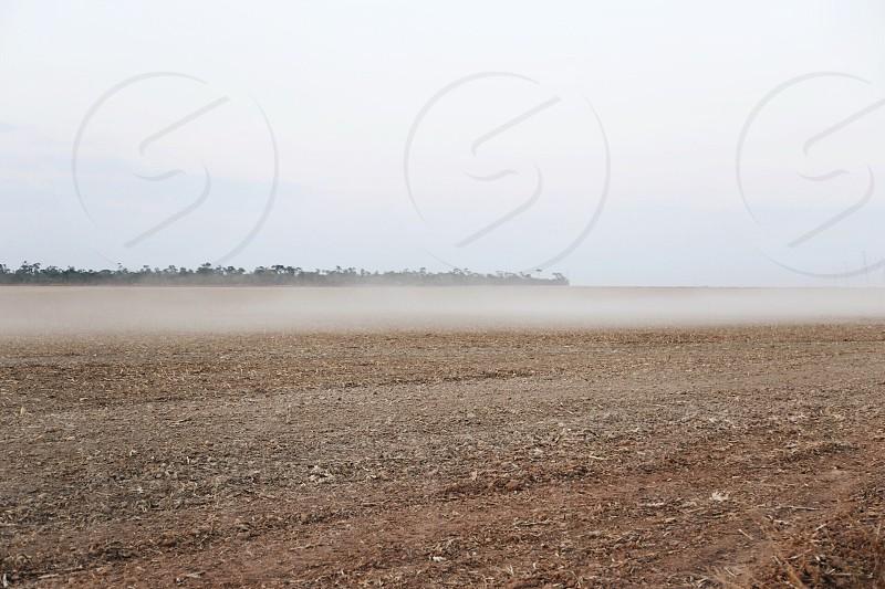 white smoke on brown ground photo