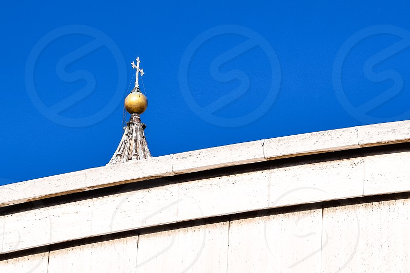 white cross church building under blue sky photo