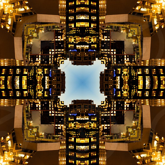 Abstract kaleidoscopic pattern of city architecture concept of illuminated office building background photo