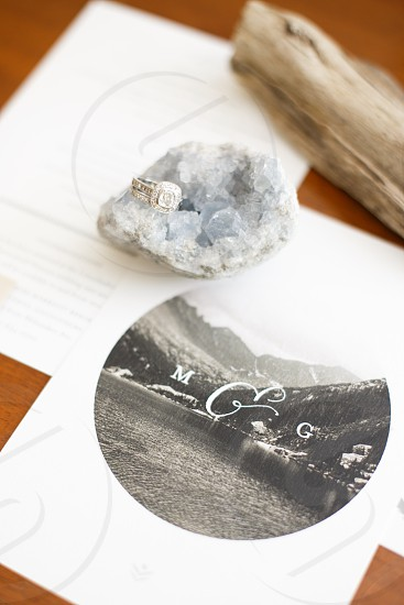 white and grey stone on top of paper photo