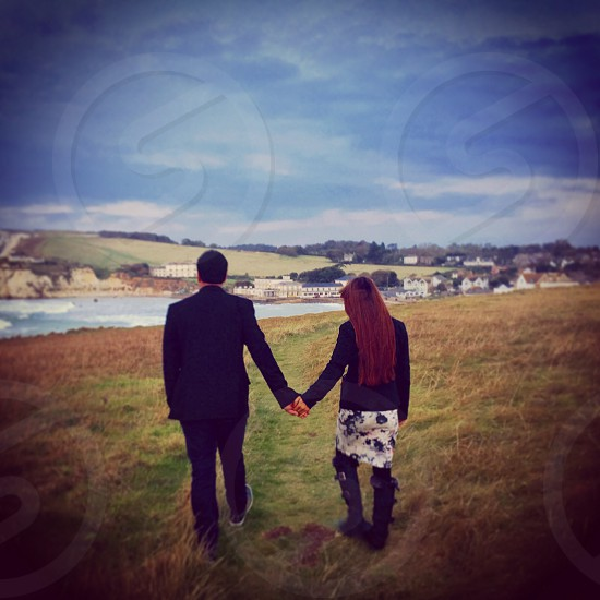 man and woman holding hands photo