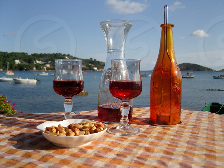Drinks by the sea holiday wine glasses decanter relaxing summer vacation photo
