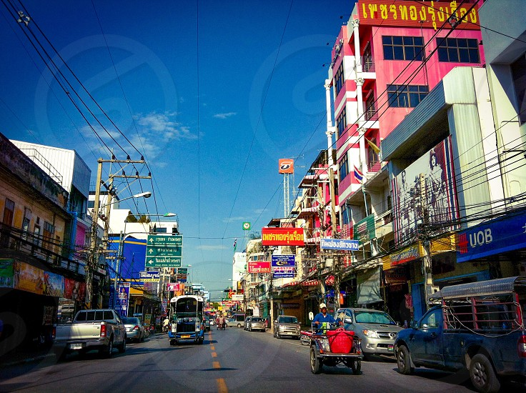 Main road in downtown business district of Nakhon Sawan City central province of Thailand photo