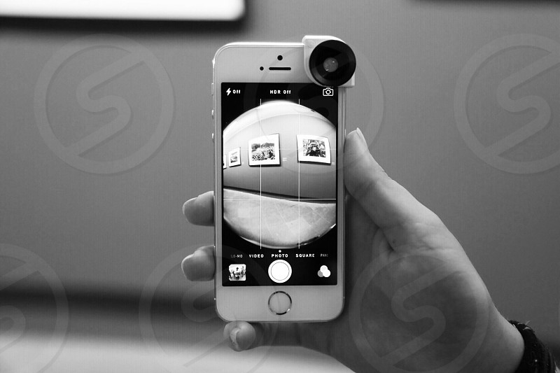 person holding iphone black and white photo photo